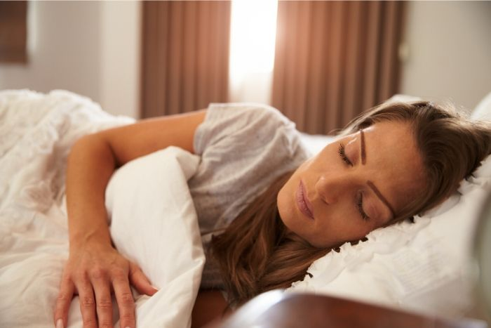 picture of a mom practicing 7 self-care ideas for moms on lockdown by sleeping