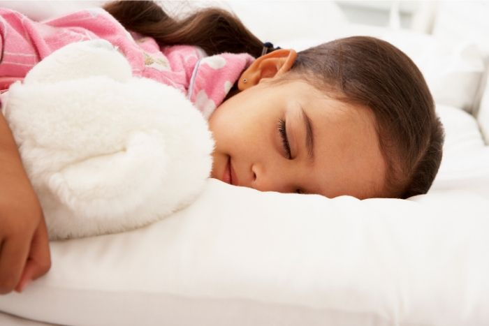 picture of little girl sleeping practing self-care 7 self-care/activities for kids during lockdown