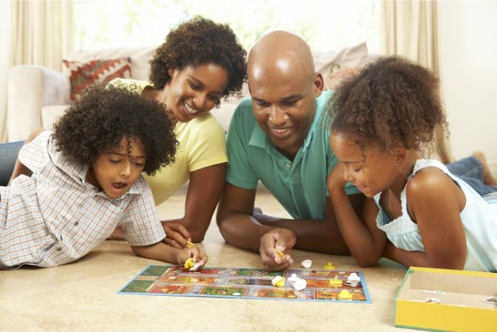 picture of a family playing board games in their living room 7 self-care/activities for kids during lockdown
