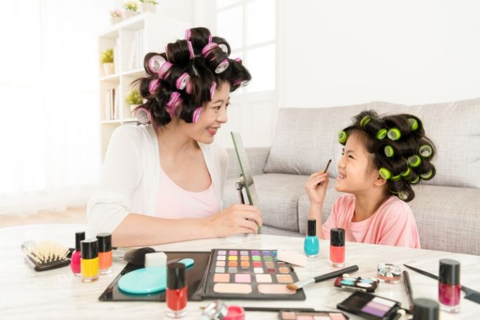 picture of mom and daughter putting make-up on