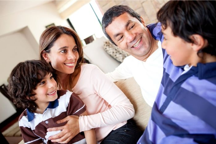 picture of a mom and dad talking to their kids at home about self-care 7 self-care/activities for kids during lockdown